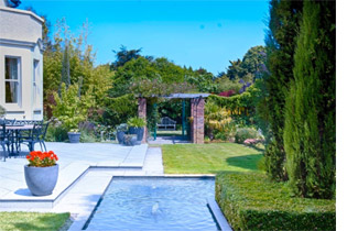 Large country garden, including a terrace and formal water feature